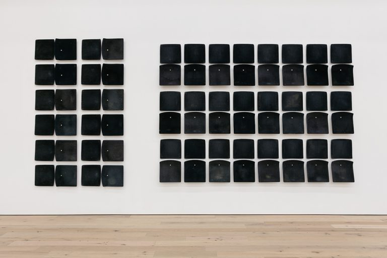 "Image of Jessica Vaughn's ""After Willis"" showing used bus seats mounted to a gallery wall"