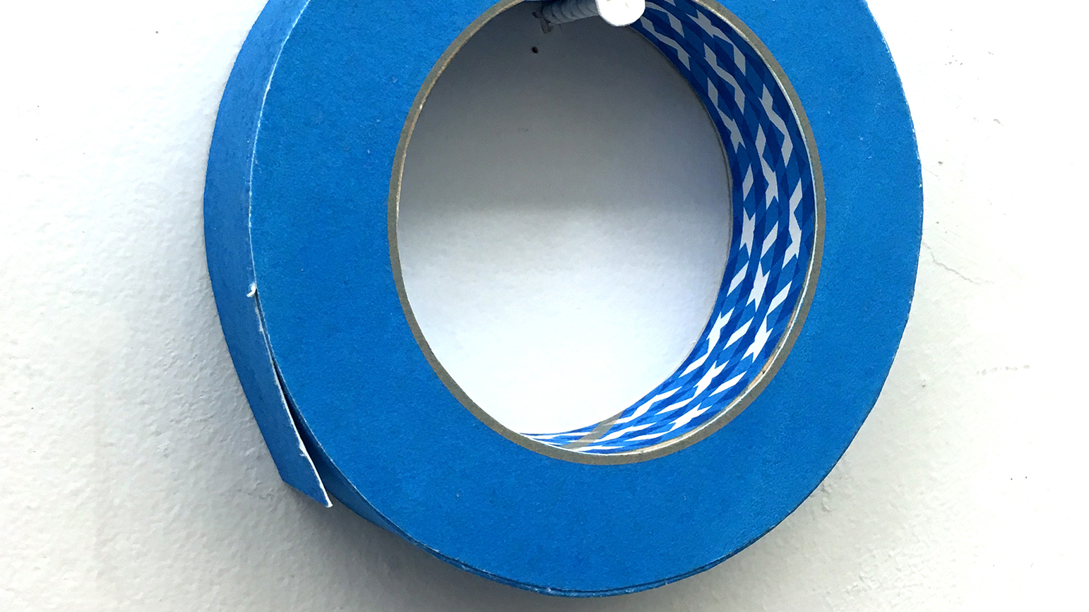 Image of a roll of blue painter's tape constructed from paper