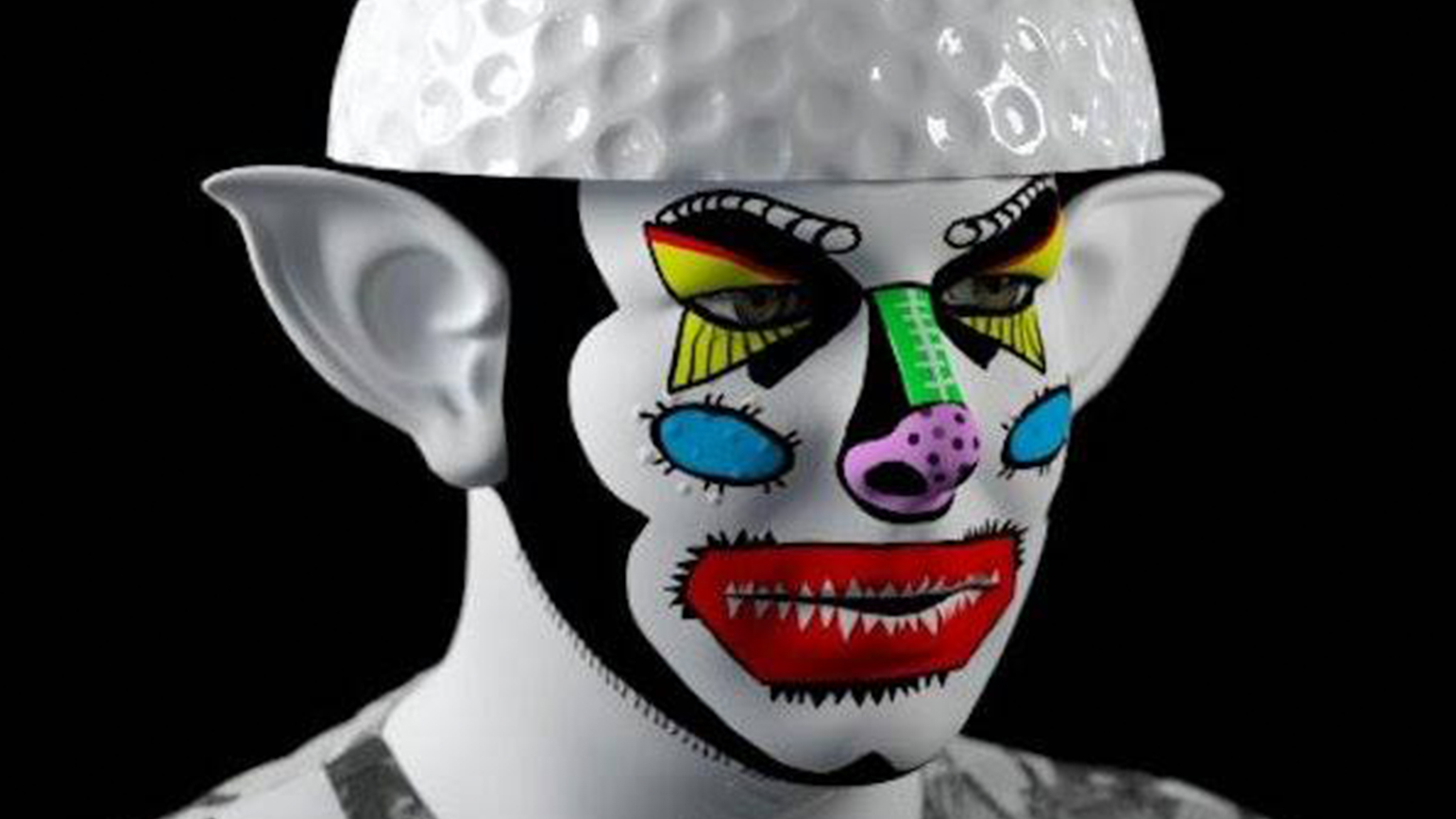 Digital image of a person with garish clown makeup