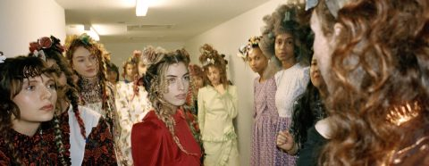 Behind-the-scenes photograph of models at a fashion show
