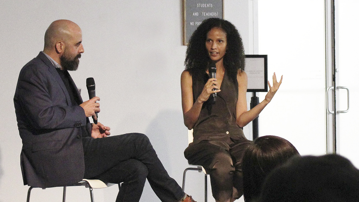 Two people having a conversation in front of an audience