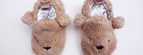 Slippers shaped like bears filled with a metal casting