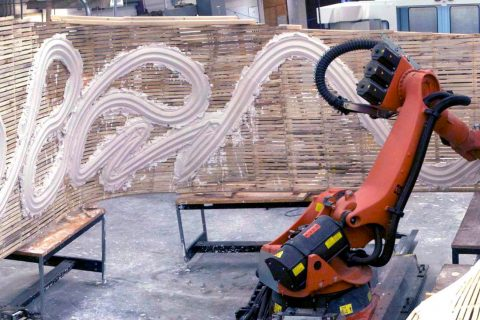 Robot applying plaster to a slatted wall