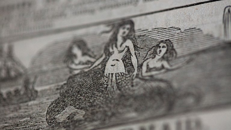 Black-and-white print of a drawing of a mermaid