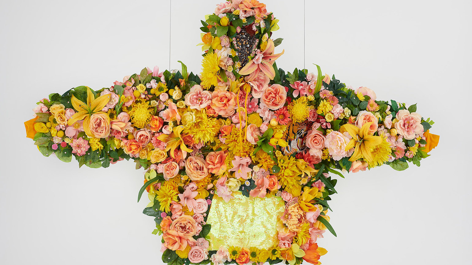 Sculpture of a hoodie covered in flowers and rhinestones