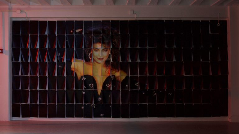 Wall-sized photo of Paula Abdul printed on tabloid-sized pieces of paper