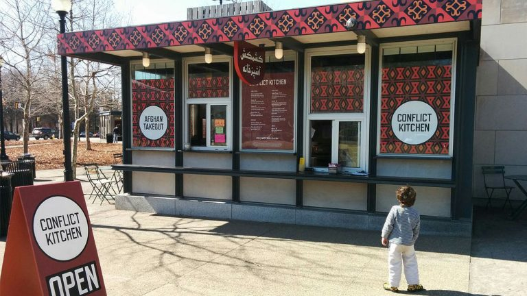 Photograph of Conflict Kitchen, a takeout kiosk decorated in with geometric patterning