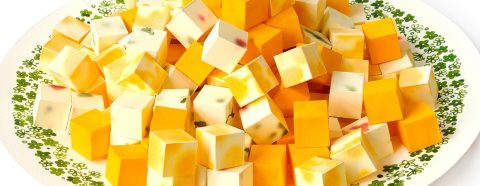 A plate of cheese cubes all made from paper