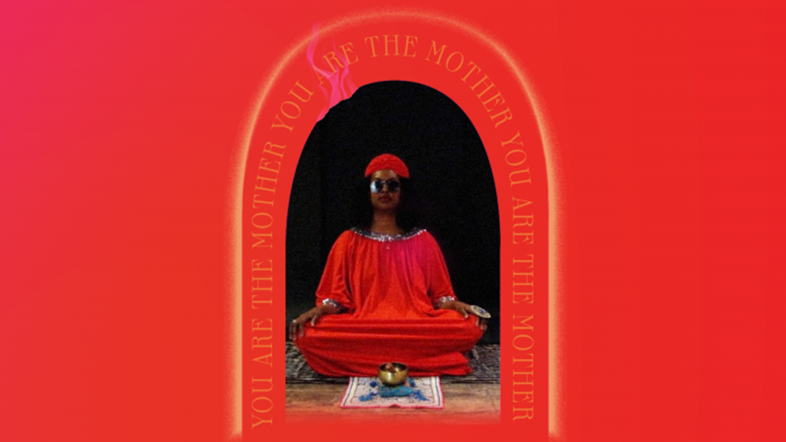 Person sitting in a mediation pose with a red background