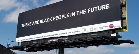 """Black billboard with the words """"There Are Black People in the Future"""""""