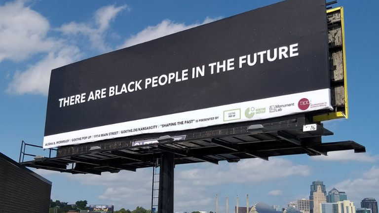 "Black billboard with the words ""There Are Black People in the Future"""