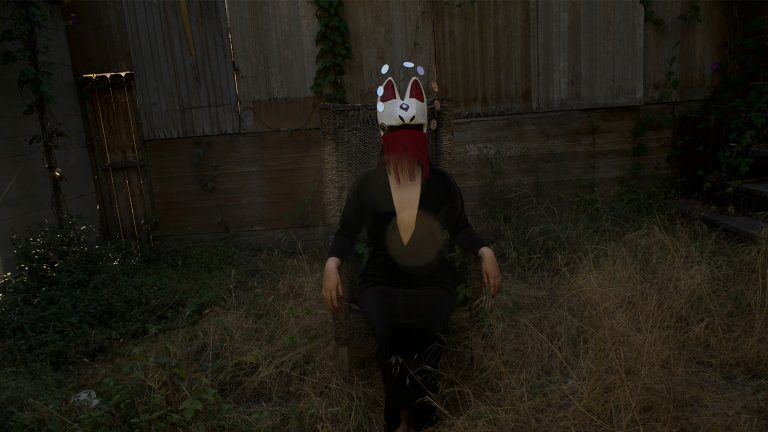 Still from a video showing a masked figured in a darkened fenced in area